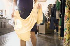 Woman Shopping for Clothes Stock Photos