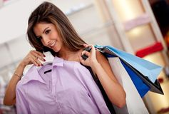 Woman shopping for clothes Stock Image