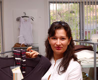 Woman shopping for clothes Royalty Free Stock Image