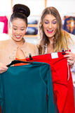Woman shopping clothes in fashion store Stock Image