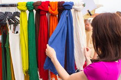 Woman shopping clothes on stall at the bazaar Royalty Free Stock Photography