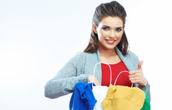 Woman shopping clothes. Studio white background Royalty Free Stock Photo