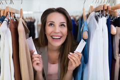 Woman shopping in a clothing store Royalty Free Stock Image