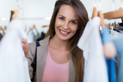 Woman shopping in a clothing store Royalty Free Stock Photography
