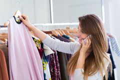 Woman shopping in a clothing store Stock Photography