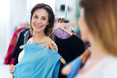 Woman shopping in a clothing store Stock Photo