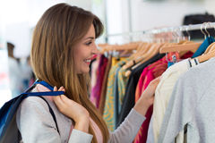 Woman shopping in a clothing store Royalty Free Stock Images