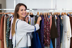 Woman shopping in a clothing store Stock Image