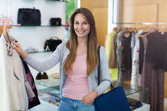 Woman shopping in a clothing store Royalty Free Stock Photo