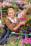 Woman shopping for colorful flowers garden center Royalty Free Stock Photo