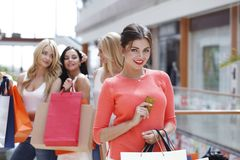 Woman shopping with credit card Royalty Free Stock Image