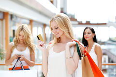 Woman shopping with credit card Royalty Free Stock Photography