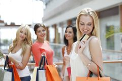 Woman shopping with credit card Stock Photos