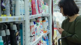 Woman shopping in the department of household products