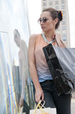 Woman shopping downtown Stock Photo