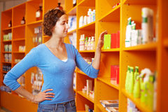 Woman shopping in drugstore Stock Images