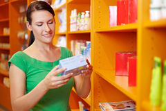 Woman shopping in drugstore Stock Image