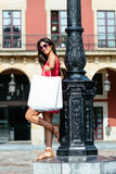 Woman shopping in european city Stock Photography