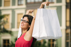 Woman shopping in european city Stock Photos