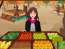 Woman shopping at a farmers market Royalty Free Stock Photos