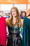 Woman shopping in fashion shop Royalty Free Stock Images