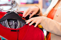 Woman shopping in fashion store Royalty Free Stock Photos