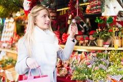 Woman shopping at festive fair Royalty Free Stock Photo