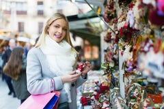 Woman shopping at festive fair Stock Photography