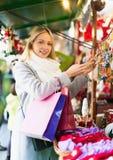 Woman shopping at festive fair Stock Photo