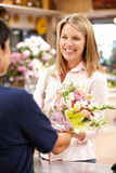 Woman shopping in florist Royalty Free Stock Photography