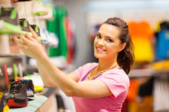 Woman shopping footwear. Happy young woman shopping for sports footwear Royalty Free Stock Photo