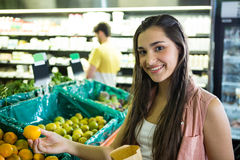 Woman shopping fresh fruit in supermarket Stock Image