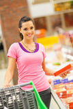 Woman shopping frozen food. Happy young woman shopping for frozen food in supermarket Stock Photo