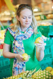 Woman shopping fruit food at store Royalty Free Stock Photography