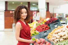 Woman shopping fruits Stock Photo