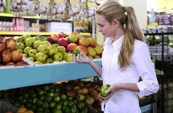 Woman shopping for fruits in the supermarket Royalty Free Stock Photo