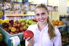Woman shopping for fruits in the supermarket Stock Photos