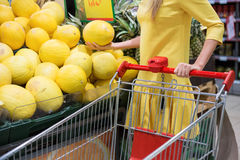 Woman shopping for fruits in supermarket Royalty Free Stock Photo