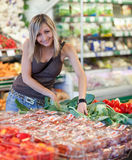 Woman shopping for fruits and vegetables Stock Photos