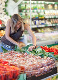 Woman shopping for fruits and vegetables Royalty Free Stock Photography