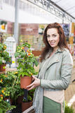 Woman shopping at gardening center Royalty Free Stock Image