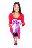 Woman Shopping giving present. Young woman in red with gift Isolated on White Royalty Free Stock Photo