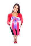 Woman Shopping giving present. Young woman in red with gift Isolated on White Stock Photo