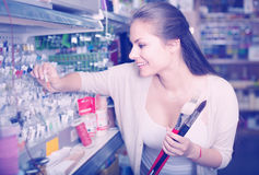 woman shopping glitter in tube Royalty Free Stock Photography