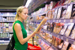 Woman shopping groceries at supermarket. Royalty Free Stock Image