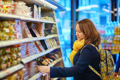 Woman shopping in a grocery store/supermarket Stock Image