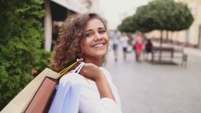 Woman in shopping. Happy woman with shopping bags enjoying in shopping. Consumerism, shopping, lifestyle concept.  stock footage