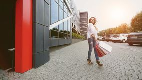 Woman in shopping. Happy woman with shopping bags enjoying in shopping. Consumerism, shopping, lifestyle concept. Slow. Motion stock footage