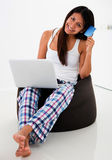 Woman shopping from her laptop Stock Photo