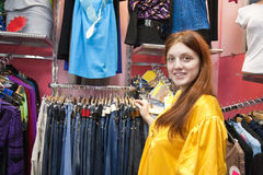 Woman shopping her outfits in  cloth store Stock Image